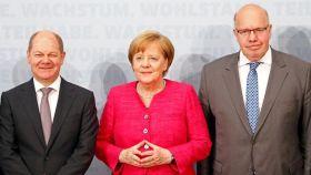 El ministro de Finanzas alemán, Olaf Scholz, la canciller Angela Merkel, y el ministro de Economía Peter Altmaier.