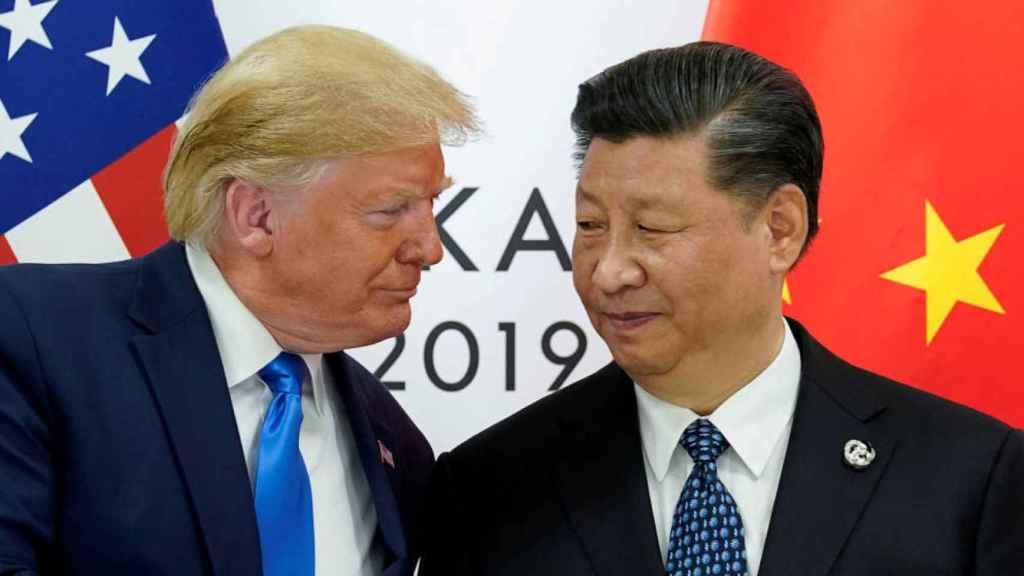 Donald Trump, junto a Xi Jinping. Reuters
