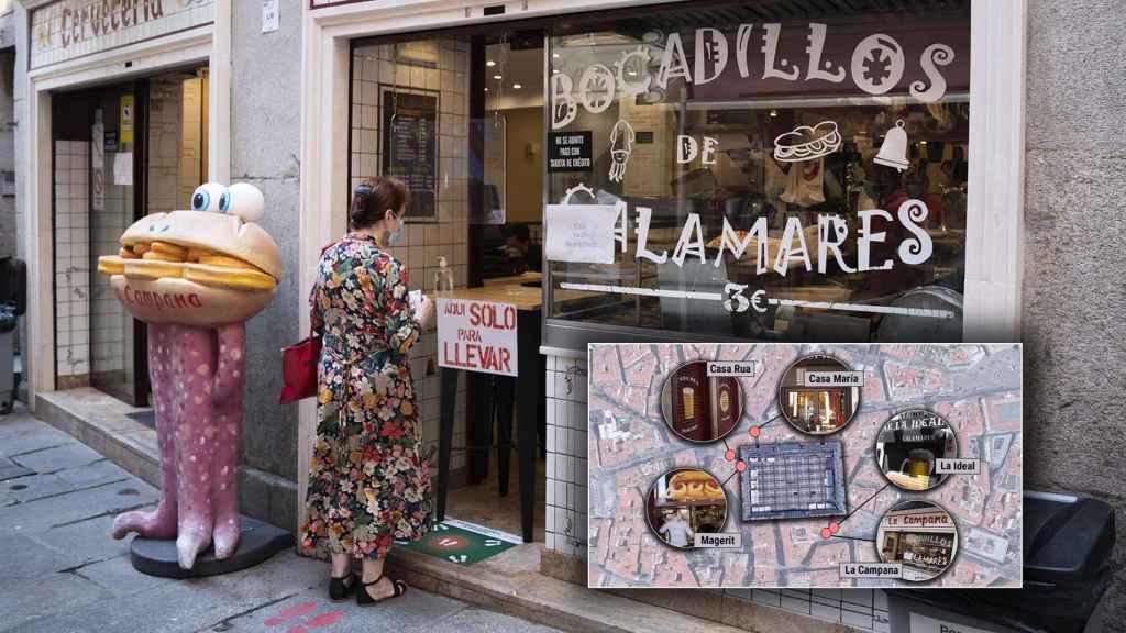 Una mujer espera a ser atendida en uno de los bares más emblemáticos de Madrid.