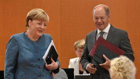 La canciller Angela Merkel y el ministro de Finanzas, el socialdemócrata Olaf Scholz.