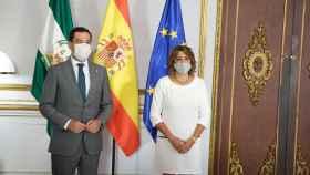 El presidente de la Junta de Andalucía, Juanma Moreno, en una reunión con la secretaria general del PSOE, Susana Díaz.