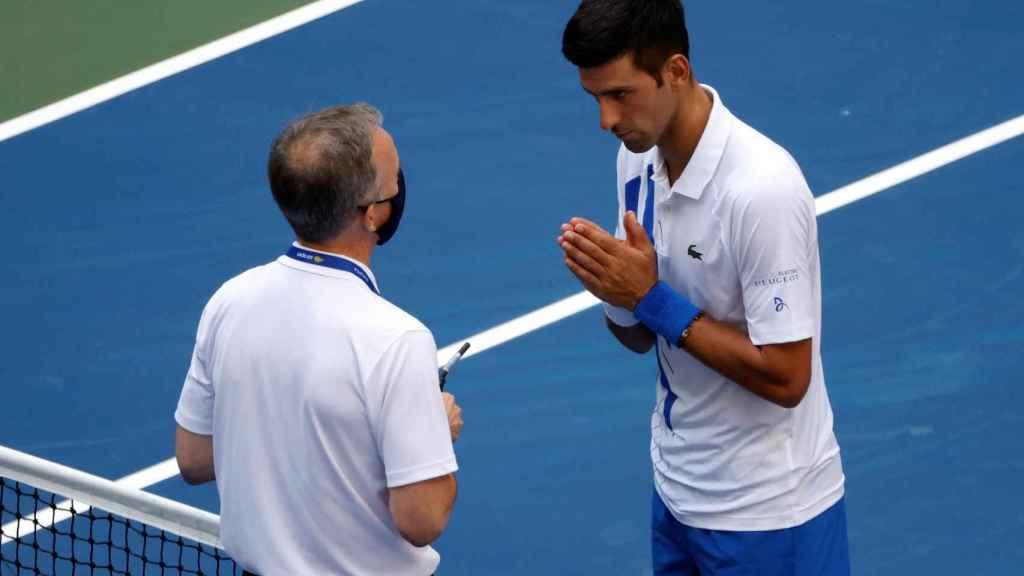 Djokovic, intentando evitar su descalificación del US Open.