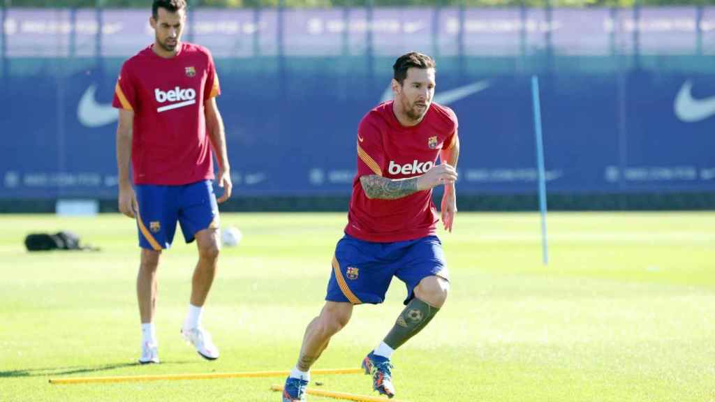 Messi y Busquets en el entrenamiento del FC Barcelona