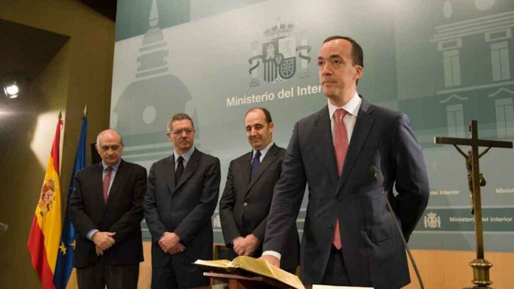 El secretario de Estado de Seguridad jurando su cargo ante Fernández Díaz.
