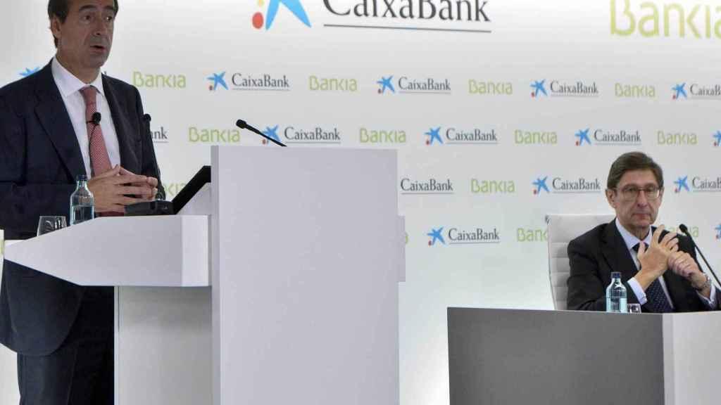La banca acelera las fusiones para ganar en rentabilidad ante el entorno de tipos negativos.
