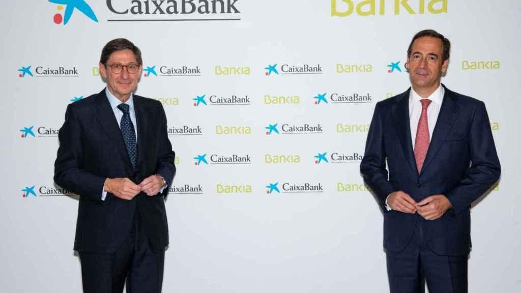 José Ignacio Goirigolzarri (Bankia) y Gonzalo Gortázar (CaixaBank).