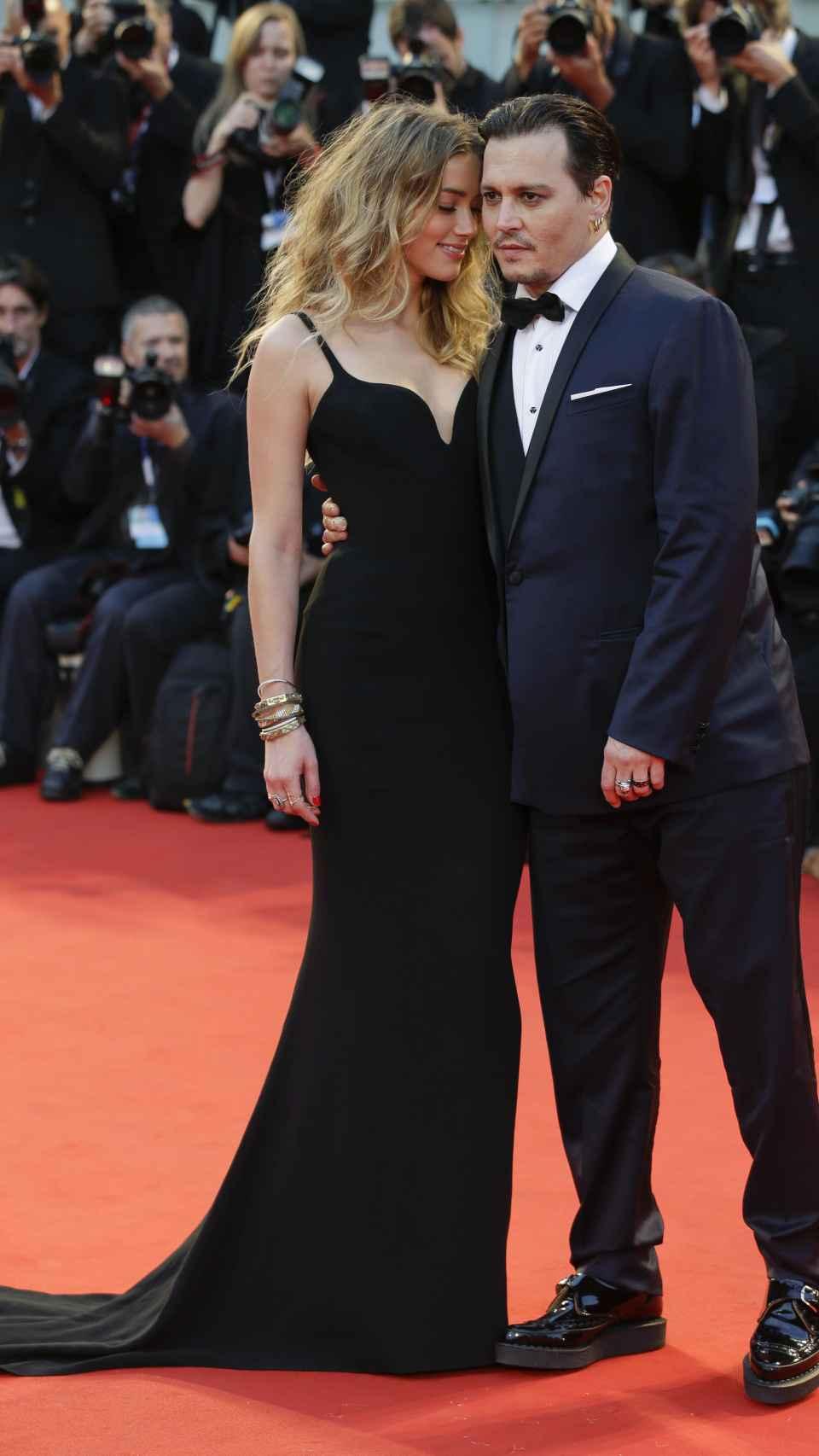 Johnny Depp y Amber Heard en el Festival de Venecia.