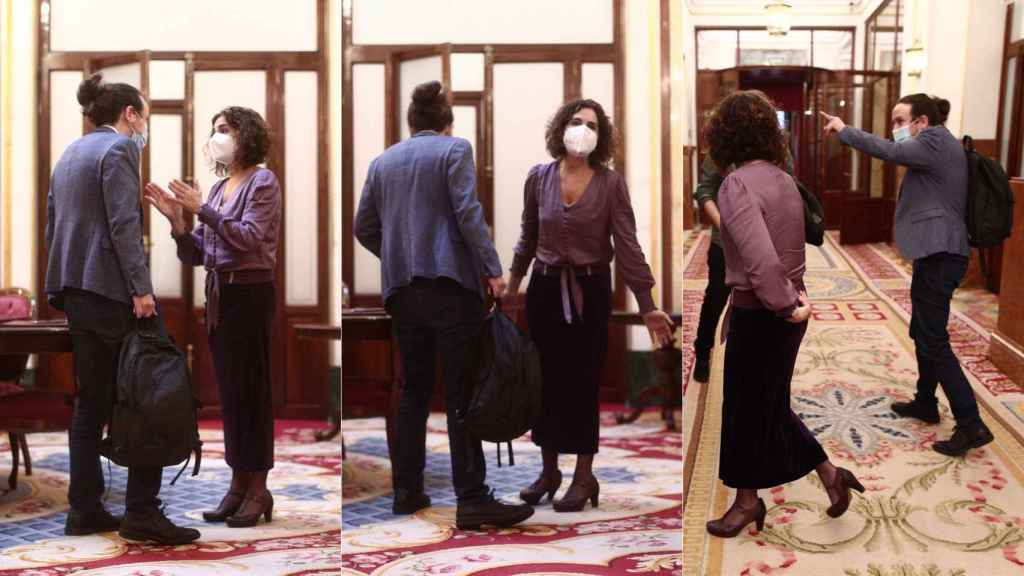 María Jesús Montero y Pablo Iglesias discuten en los pasillos del Congreso.