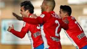 Los jugadores del Navalcarnero celebran el segundo gol de Juan Esnáider al Eibar