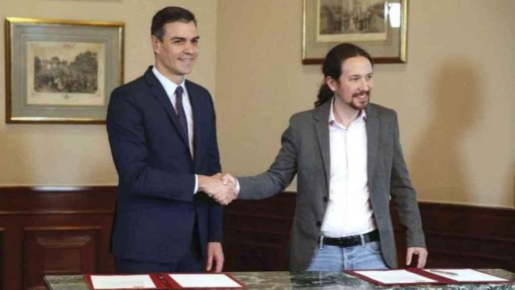 Sánchez e Iglesias, en 2019 tras firmar su preacuerdo de Gobierno.