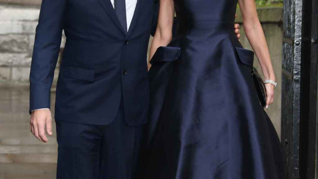 Lachlan, his more than possible successor, along with his wife, Sarah Murdoch.