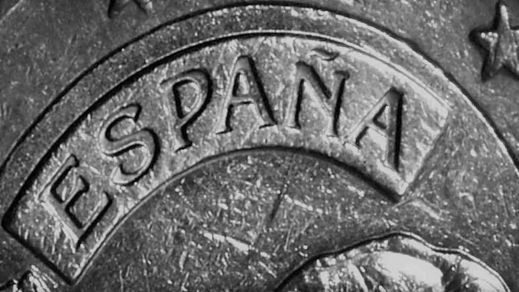 Detalle de una moneda española de un euro.