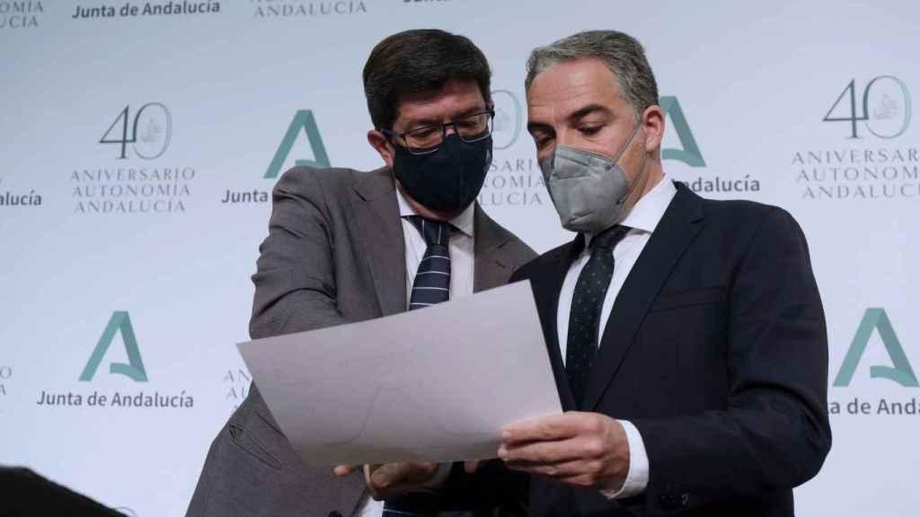 Juan Marín y Elías Bendodo.