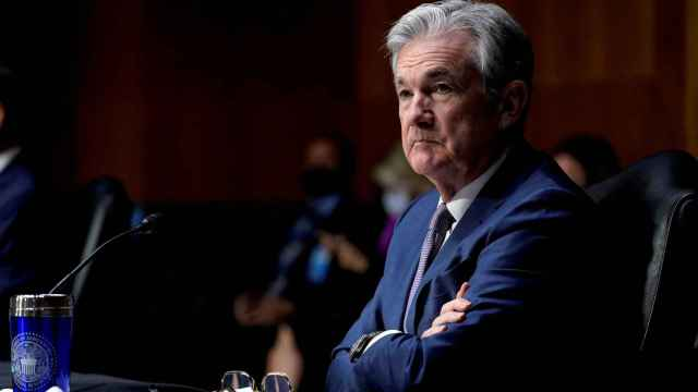 FILE PHOTO: Chair of the Federal Reserve Jerome Powell listens during a Senate Banking Committee hearing in Washington