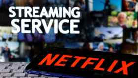 FILE PHOTO: A smartphone with the Netflix logo is seen on a keyboard in front of displayed Streaming service words in this illustration