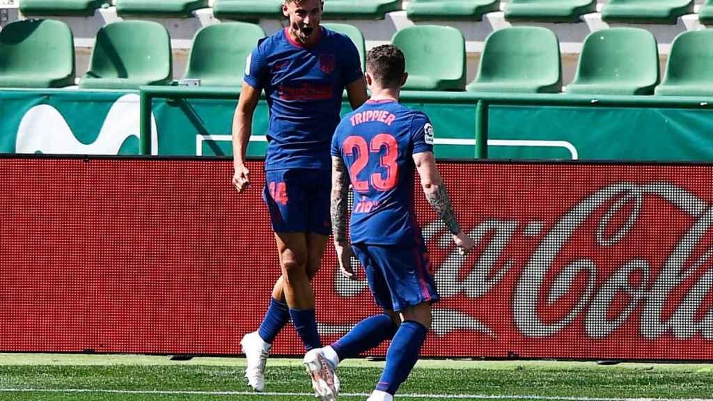 Marcos Llorente celebra su gol con Trippier