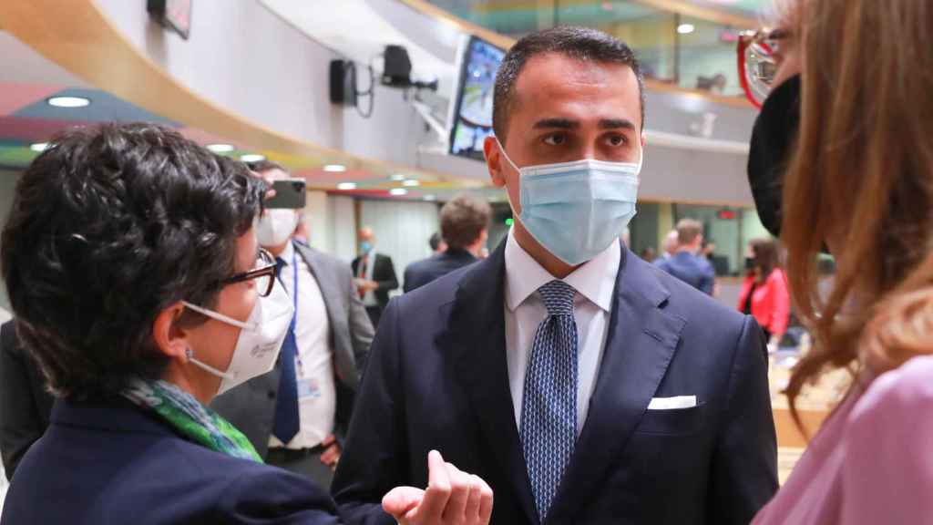 González Laya conversa con su homólogo italiano durante la reunión de este lunes en Bruselas