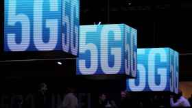 FILE PHOTO: Hanging cubes display 5G logo at the Mobile World Congress in Barcelona