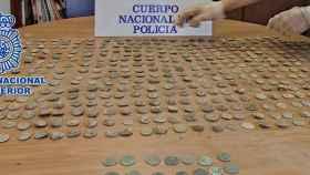 Las monedas que habían sido expoliadas.