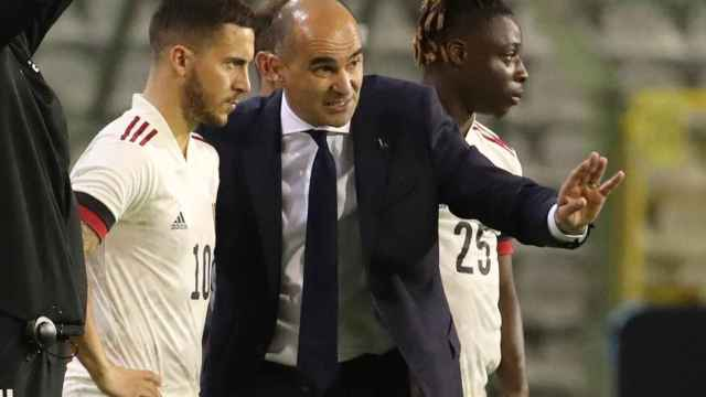 Roberto Martínez y Eden Hazard, en un partido de la selección de Bélgica