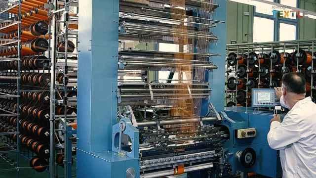 Un trabajo mecanizado en una industria textil catalana.