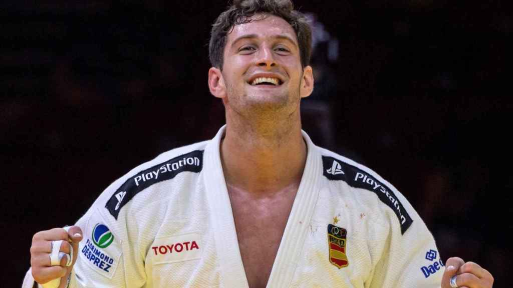 El español Nikoloz Sherazadishvili celebra su victoria