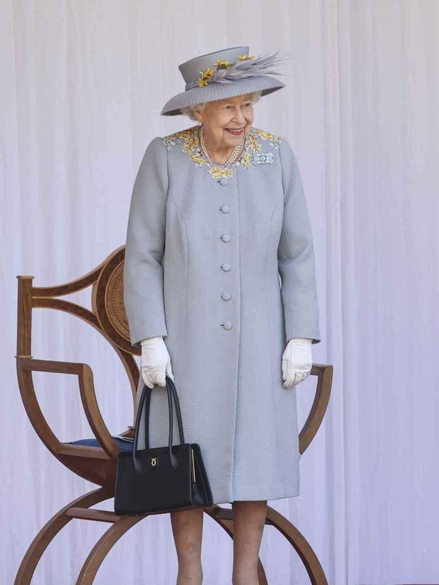 Pese a ser una celebración triste, la Reina se ha mostrado sonriente en algún momento.