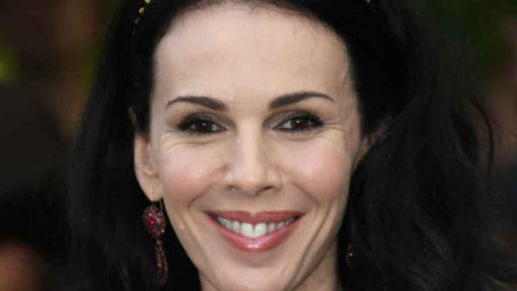 The L'Wren Scott garments will be auctions to raise funds for a fashion scholarship.