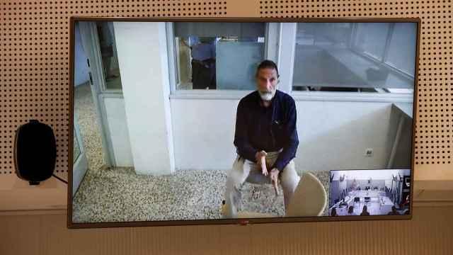 John McAfee, durante la videoconferencia en la que intervino ante la Audiencia Nacional./