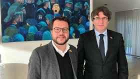 El presidente de la Generalitat, Pere Aragonés, junto al expresidente Carles Puigdemont.