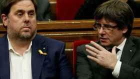 Carles Puigdemont y Oriol Junqueras en 2017. Reuters