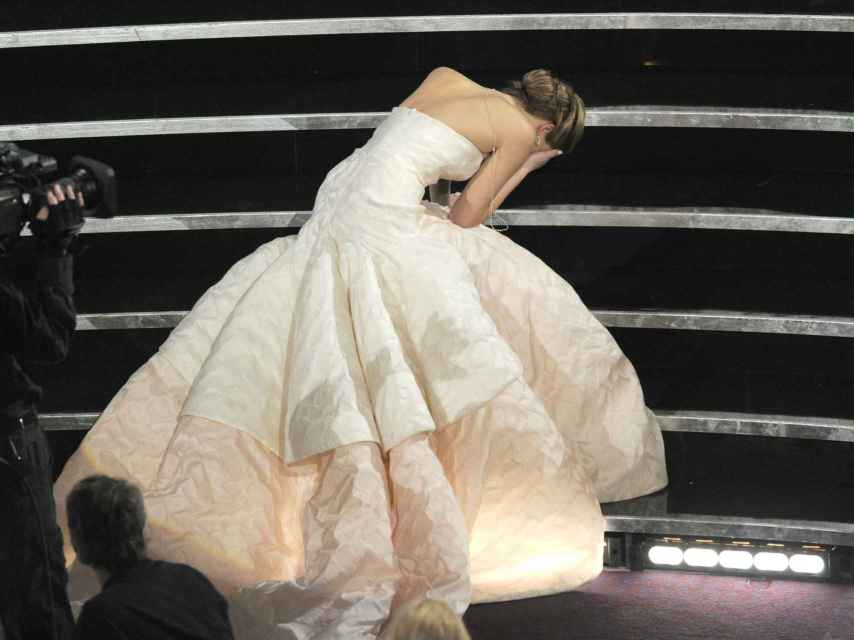 Jennifer Lawrence tripped over her Dior dress as she walked up the stairs to collect her award.