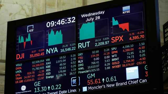A screen displays the Dow Jones Industrial Average on the floor of the New York Stock Exchange (NYSE) in New York City