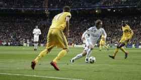 Mario Mandzukic y Luka Modric, en un partido entre la Juventus y el Real Madrid
