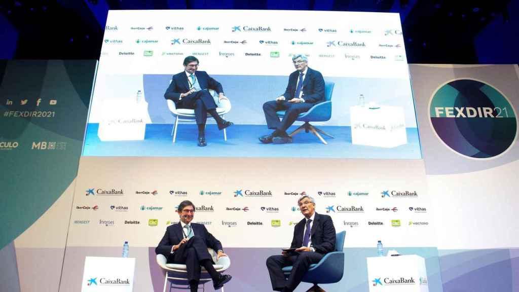 El Presidente de Caixabank, José Ignacio Goirigolzarri, y el Presidente de Deloitte España, Fernando Ruiz (d), durante la primera ponencia del III Forum Excelencia Directiva FEXDIR 21 bajo el título Las personas en el centro de la recuperación
