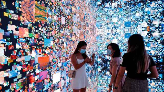 Visitors are pictured in front of an art installation which will be converted into NFT and auctioned online at Sotheby's, in Hong Kong