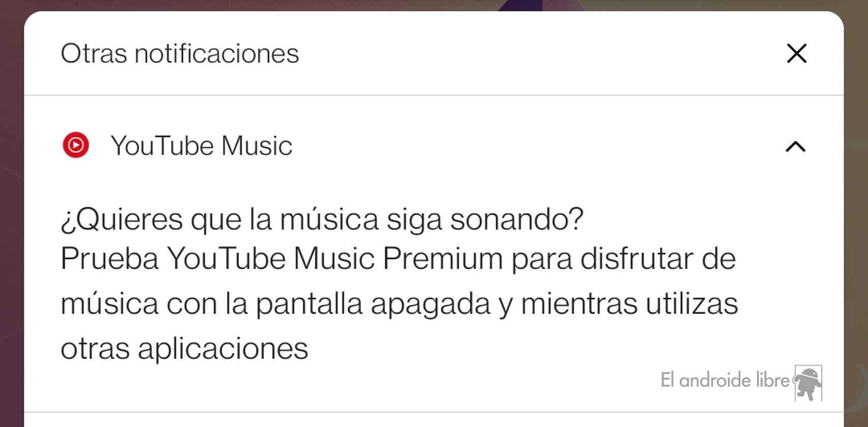 Mensaje actual de Youtube Music en su versión gratuita cuando no tenemos la app en primer plano